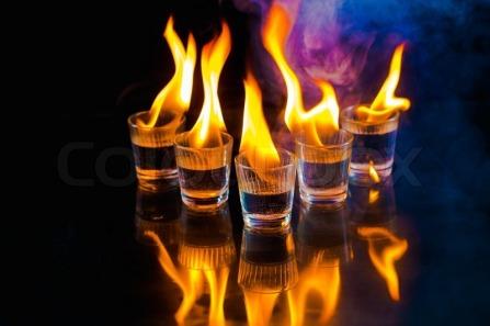 10751208-glasses-with-burning-alcohol-on-black-background